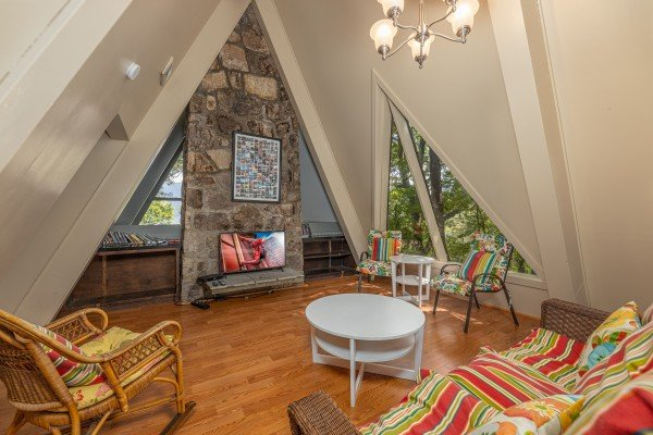 Loft area with rocking chairs and sofa at Terrace Garden Manor, a 13 bedroom cabin rental located in Gatlinburg