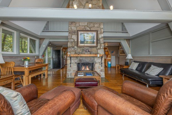 Living room with a fireplace at Terrace Garden Manor, a 13 bedroom cabin rental located in Gatlinburg