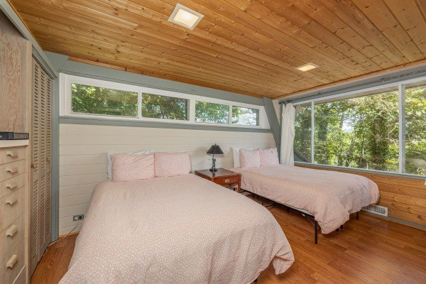 Bedroom with two beds at Terrace Garden Manor, a 13 bedroom cabin rental located in Gatlinburg
