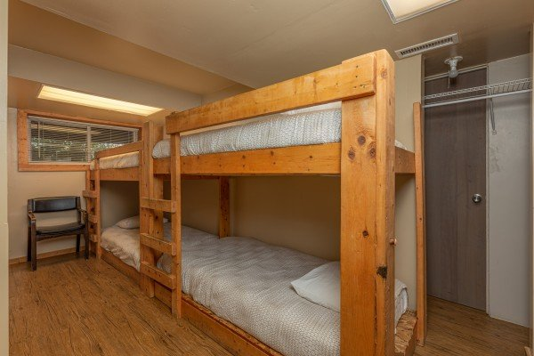 Room with two sets of bunk beds at Terrace Garden Manor, a 13 bedroom cabin rental located in Gatlinburg