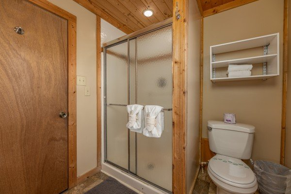 Bathroom with shower at Terrace Garden Manor, a 13 bedroom cabin rental located in Gatlinburg
