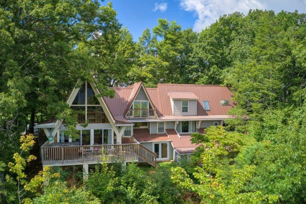 Tucked into the trees on the hillside at Terrace Garden Manor, a 13 bedroom cabin rental located in Gatlinburg