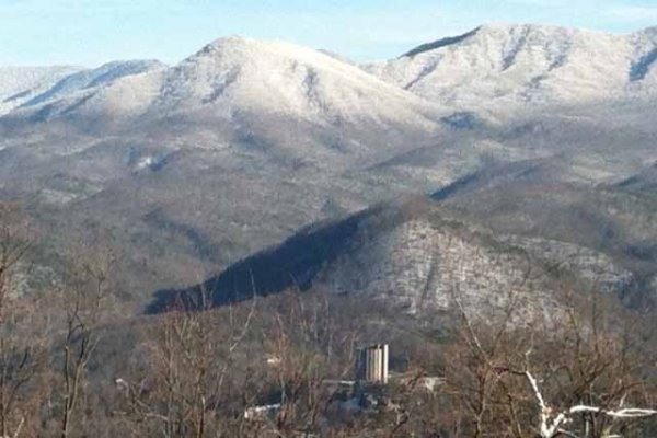 Smoky Mountains with snow as seen at Terrace Garden Manor, a 13 bedroom cabin rental located in Gatlinburg