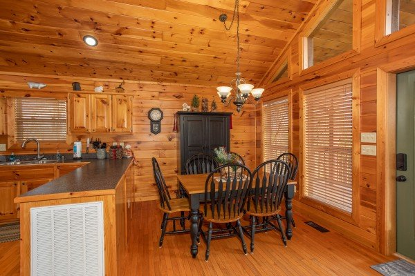 Dining table with seating for six at Secluded View, a 2-bedroom cabin rental in Pigeon Forge