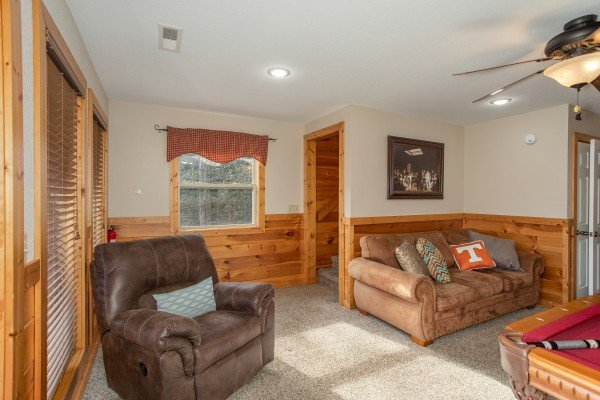 Game room seating near the pool table at Secluded View, a 2-bedroom cabin rental in Pigeon Forge