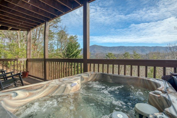 Hot tub overlooking the mountain view at Secluded View, a 2-bedroom cabin rental in Pigeon Forge