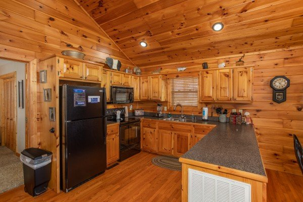 Kitchen with black appliances at Secluded View, a 2-bedroom cabin rental in Pigeon Forge