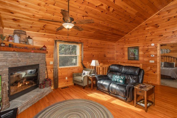 Living room with a fireplace and loveseat at Secluded View, a 2-bedroom cabin rental in Pigeon Forge