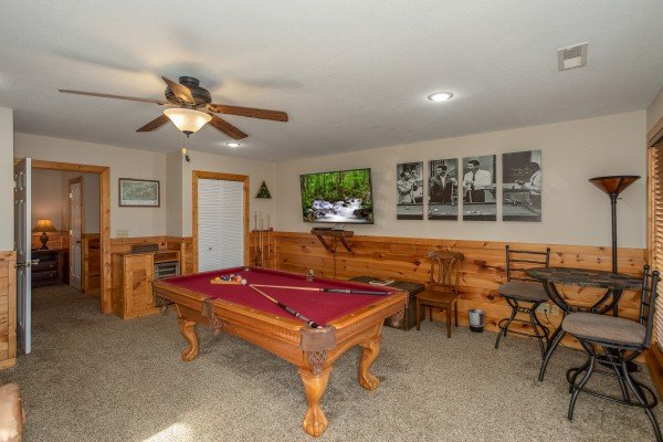 Red pool table in the lower level game room at Secluded View, a 2-bedroom cabin rental in Pigeon Forge