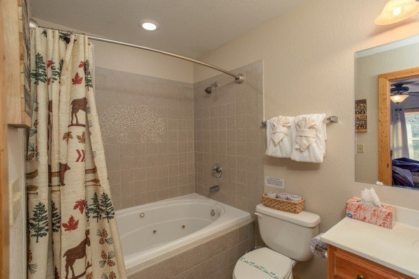Jacuzzi tub and shower with custom bear mosaic at Secluded View, a 2-bedroom cabin rental in Pigeon Forge
