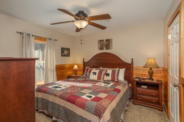 Bedroom with a king bed at Secluded View, a 2-bedroom cabin rental in Pigeon Forge