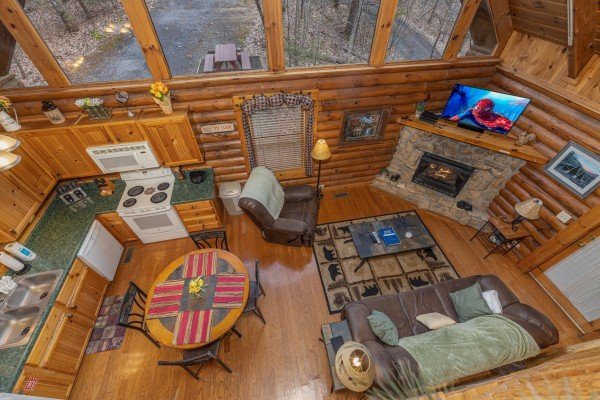 Looking down at the living, dining, and kitchen spaces at A Lover's Secret, a 1 bedroom cabin rental located in Gatlinburg