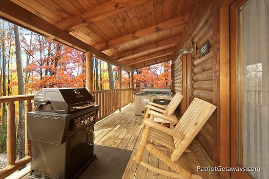Chairs and grill on deck at A Lover's Secret a 1 bedroom cabin rental located in Gatlinburg
