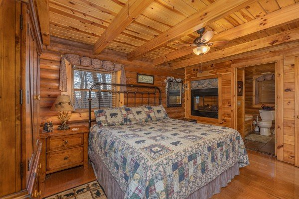 Bedroom with a double-sided fireplace at A Lover's Secret, a 1 bedroom cabin rental located in Gatlinburg
