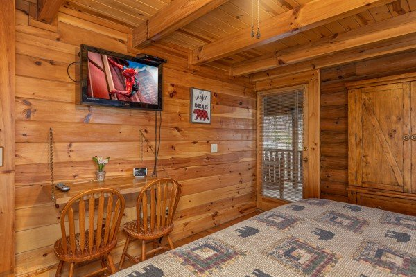 Writing desk and TV in a bedroom at A Lover's Secret, a 1 bedroom cabin rental located in Gatlinburg