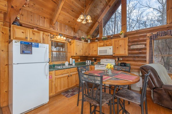 Kitchen and dining space at A Lover's Secret, a 1 bedroom cabin rental located in Gatlinburg