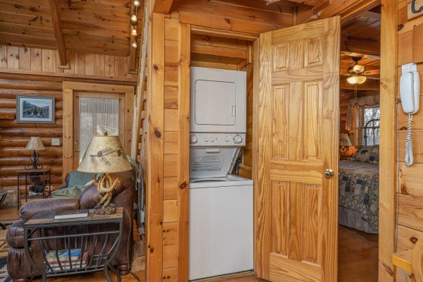 Stacked washer and dryer at A Lover's Secret, a 1 bedroom cabin rental located in Gatlinburg