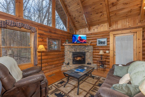 Living room with a fireplace and TV at A Lover's Secret, a 1 bedroom cabin rental located in Gatlinburg