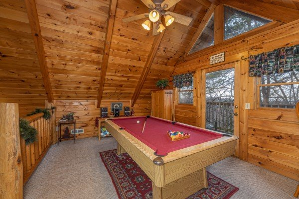 Red felt pool table at A Lover's Secret, a 1 bedroom cabin rental located in Gatlinburg