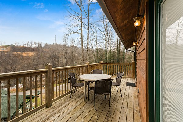 Deck dining for four at Omg! A 2 bedroom cabin rental located in Gatlinburg