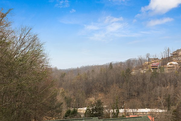 Looking out onto the hillside from the deck at Omg! A 2 bedroom cabin rental located in Gatlinburg