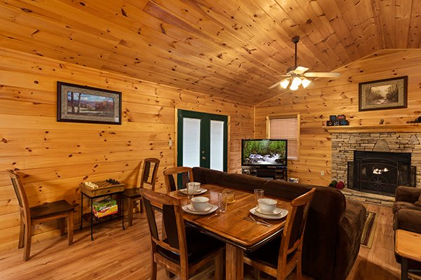 Dining table for three and a checker table at Omg! A 2 bedroom cabin rental located in Gatlinburg