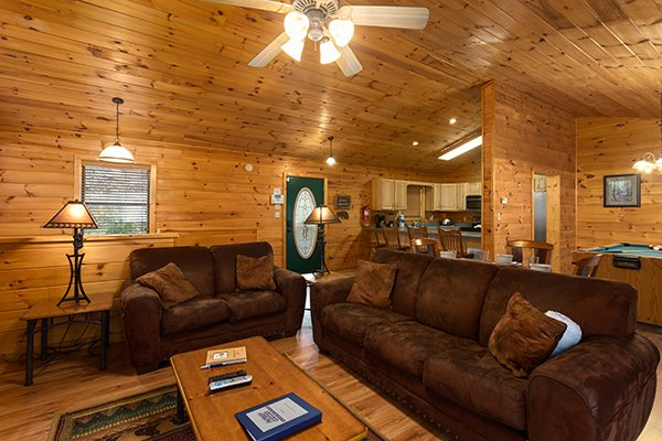 Open concept main floor with living room, dining space, and kitchen at Omg! A 2 bedroom cabin rental located in Gatlinburg
