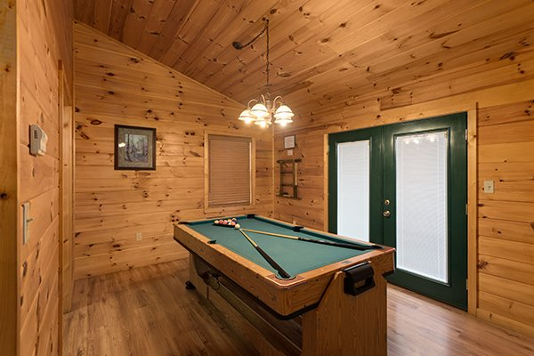 Pool table on the main floor at Omg! A 2 bedroom cabin rental located in Gatlinburg