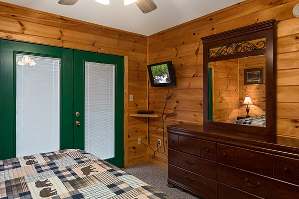Bedroom with a TV and dresser at Omg! A 2 bedroom cabin rental located in Gatlinburg