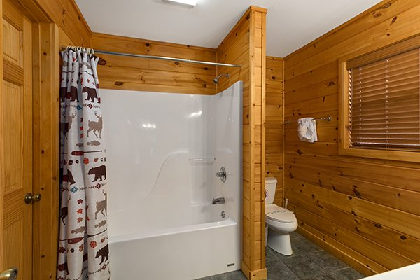 En suite bath with a tub and shower at Omg! A 2 bedroom cabin rental located in Gatlinburg