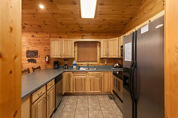 Kitchen with stainless appliances at Omg! a 2 bedroom cabin rental located in gatlinburg