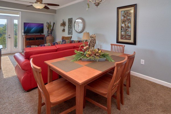 Dining table for four at River Dreamin', a 2 bedroom cabin rental located in Pigeon Forge