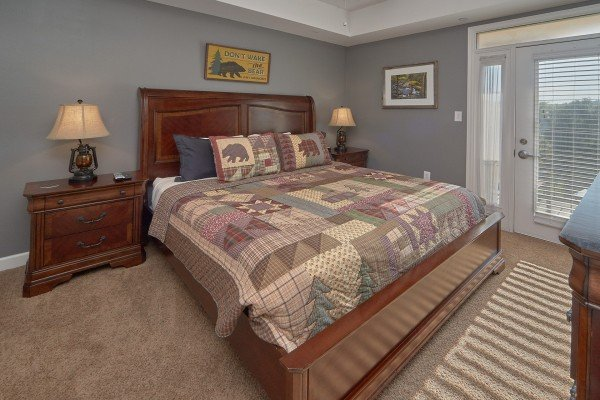 Bedroom with a king bed and deck balcony access at River Dreamin', a 2 bedroom cabin rental located in Pigeon Forge