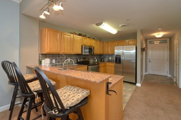 Kitchen with stainless appliances and counter seating at River Dreamin', a 2 bedroom cabin rental located in Pigeon Forge
