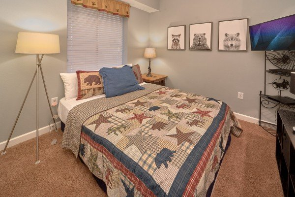 Bedroom with a queen bed, dresser, and TV at River Dreamin', a 2 bedroom cabin rental located in Pigeon Forge