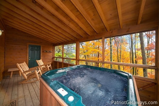 Hot tub in screened in deck at Hooked on Bears, a 2 bedroom cabin rental located in Pigeon Forge