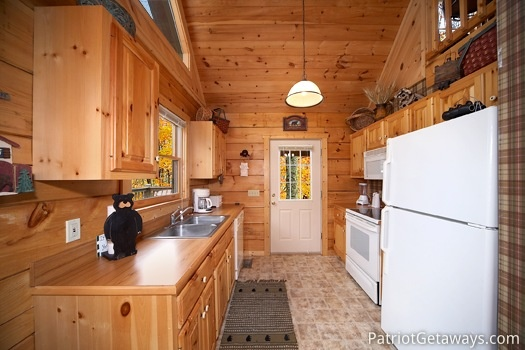 Kitchen with white appliances at Hooked on Bears, a 2 bedroom cabin rental located in Pigeon Forge