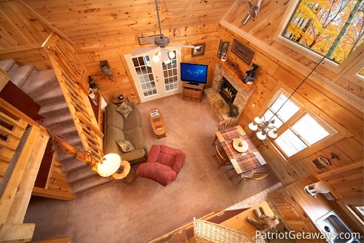 Looking down into the living room from the loft at Hooked on Bears, a 2 bedroom cabin rental located in Pigeon Forge