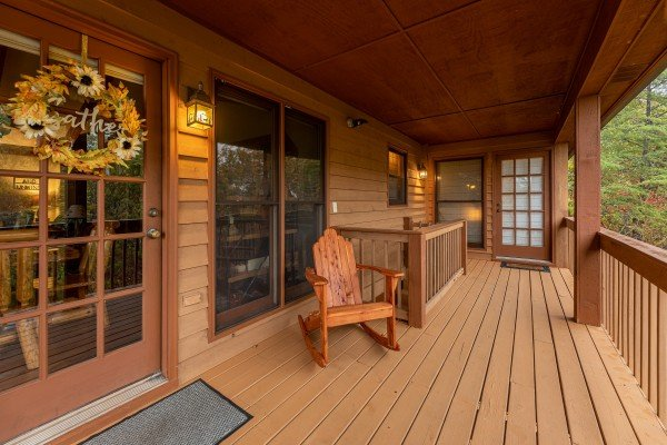 Rocking chair on the covered deck at Lazy Bear Retreat, a 4 bedroom cabin rental located in Pigeon Forge