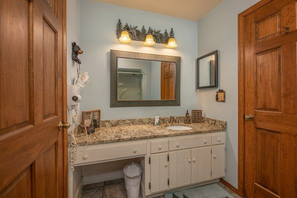 Vanity and dressing area in a bathroom at Lazy Bear Retreat, a 4 bedroom cabin rental located in Pigeon Forge