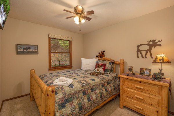 Bedroom with log bed and night stand at Lazy Bear Retreat, a 4 bedroom cabin rental located in Pigeon Forge