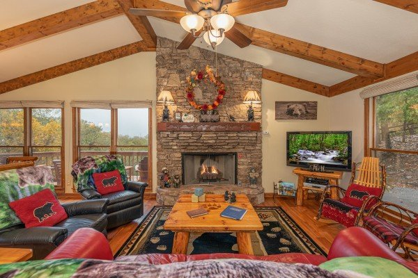 Living room with two recliners, sofa, fireplace, and TV at Lazy Bear Retreat, a 4 bedroom cabin rental located in Pigeon Forge