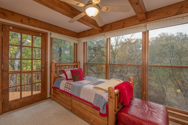 Twin bed upstairs in the futon room at Lazy Bear Retreat, a 4 bedroom cabin rental located in Pigeon Forge
