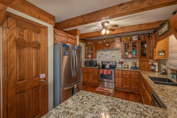 Kitchen with stainless appliances at Lazy Bear Retreat, a 4 bedroom cabin rental located in Pigeon Forge