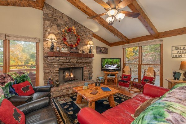 Fireplace and TV in a living room at Lazy Bear Retreat, a 4 bedroom cabin rental located in Pigeon Forge