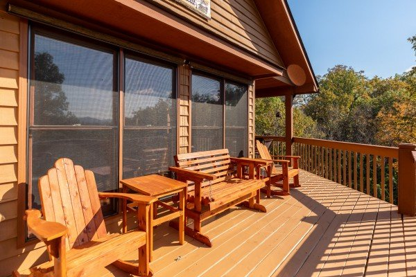 Adirondack rocker and loveseat glider on the open deck at Lazy Bear Retreat, a 4 bedroom cabin rental located in Pigeon Forge
