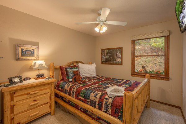 Bedroom with a log bed and night stand at Lazy Bear Retreat, a 4 bedroom cabin rental located in Pigeon Forge