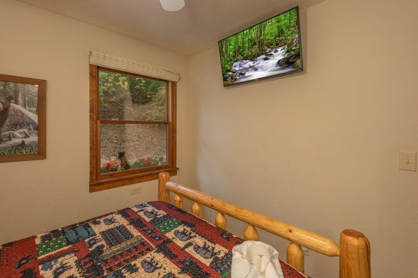 Wall mounted TV in a bedroom at Lazy Bear Retreat, a 4 bedroom cabin rental located in Pigeon Forge