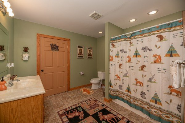 Bathroom with a tub and shower at Lazy Bear Retreat, a 4 bedroom cabin rental located in Pigeon Forge