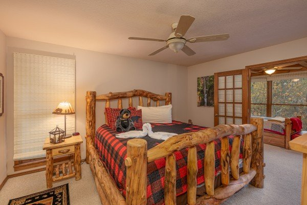 Bedroom with a log bed and separate sleeping area at Lazy Bear Retreat, a 4 bedroom cabin rental located in Pigeon Forge